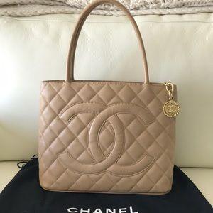 Chanel beige caviar medallion tote bag